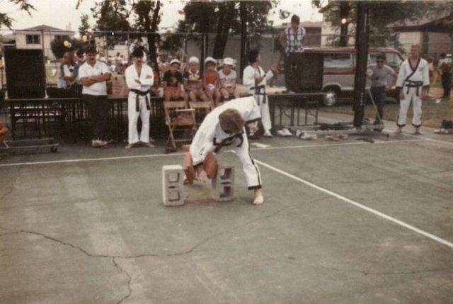 Master Knueppel breaks two bricks at a demonstration in Chicago, IL